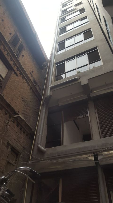 8 storeyed house in a commercial area